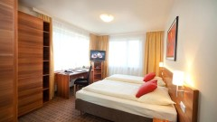 Spacious double room at the privately owned city Hotel Astoria in Salzburg