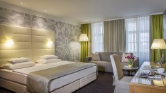Doppelbett im Hotel Das TIGRA in Wien