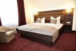 Einladendes Doppelbett im Hotel Prinzregent in Nürnberg