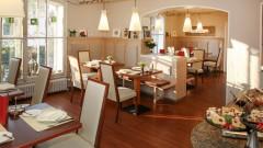 Der gemütliche Speisesaal im Hotel Rosenvilla in Salzburg