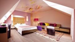 Individuell gestaltete Zimmer im Kunst Hotel Der Wilhelmshof in Wien